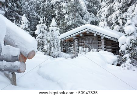 Small Wooden Blockhouse Under White Snow