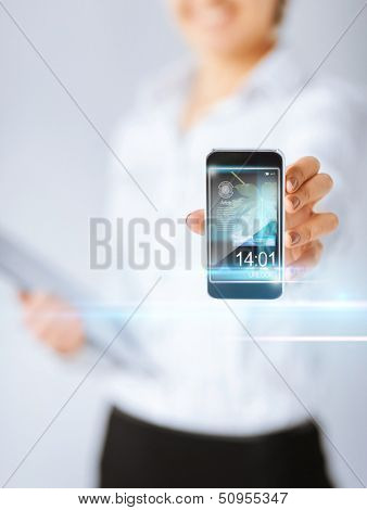 technology, internet, tv and news concept - woman hand with smartphone, videos and virtual screen