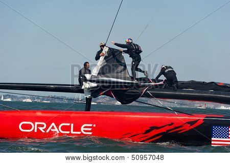 SAN FRANCISCO, CA - SEPTEMBER 12: The crew of Oracle Team USA changes sails in the America's Cup sailing races in San Francisco, CA on September 12, 2013