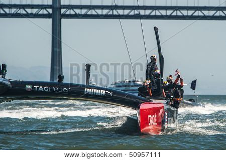 SAN FRANCISCO, CA - SEPTEMBER 12: Emirates Team New Zealand crew waves to crowd their America's Cup race in San Francisco, CA on September 12, 2013