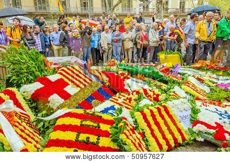 BARCELONA, SPAIN - SEPTEMBER 11: Catalonia people participate in floral offerings to the monument of  Rafael Casanova during the National Day of Catalonia, Barcelona, Spain on September 11, 2013