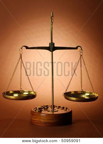 Classic scales on brown background