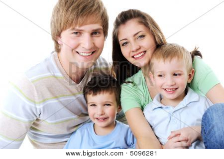 Portrait Of Happy Laughing Young Family With Two Sons