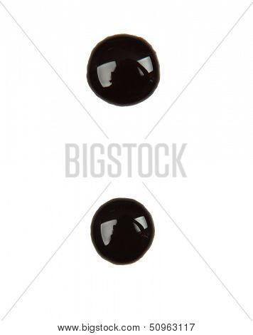 Punctuation mark  made from chocolate syrup, isolated on  white