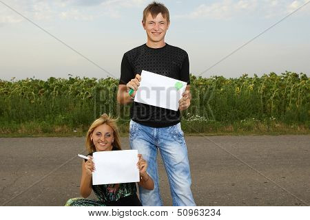 Funny Couple  Shows Blank Piece Of Paper