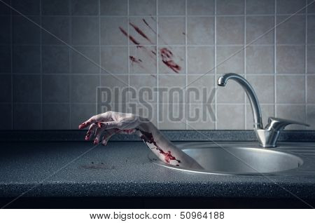 Bloody hand in kitchen sink, crime or Halloween concept