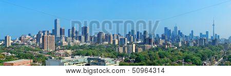 Toronto skyline panorama with urban architecture and blue sky