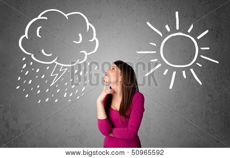 Pretty young woman standing and wondering between the sun and rain drawings