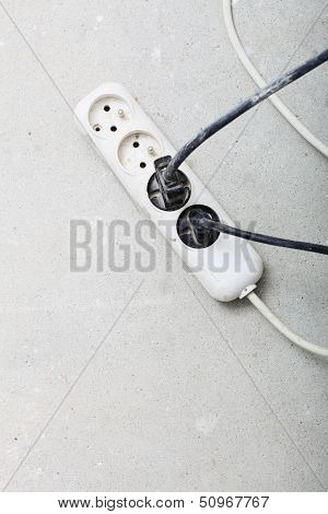 Electrical Cords Connected To Power Strip Building Site