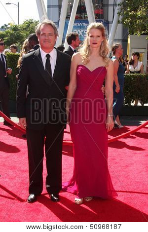 LOS ANGELES - SEP 15:  Graham Yost, Joelle Carter at the Creative Emmys 2013 - Arrivals at Nokia Theater on September 15, 2013 in Los Angeles, CA