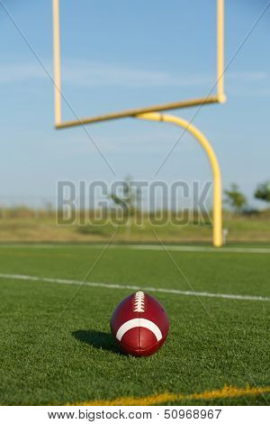 American Football on the Field with Goalposts or Uprights Beyond
