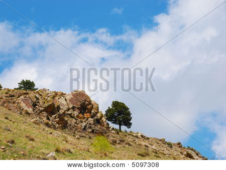 Rocky Outcrop On The Edge Of A Hillside