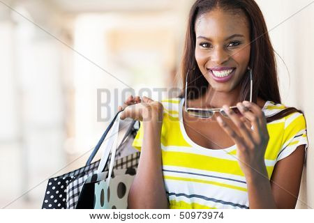 cheerful african american woman shopping in mall