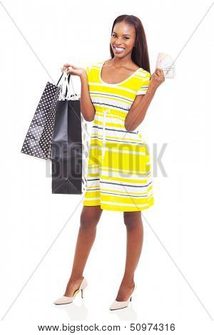 beautiful young african american woman with cash to spend on shopping spree