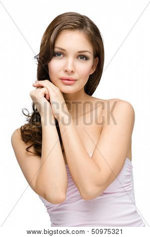 Half-length portrait of girl with hair ringlets touching her face, isolated on white. Concept of beauty and youth