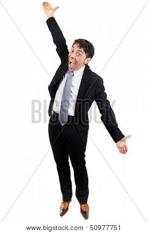 Excited middle-aged businessman in a suit celebrating an achievement or success cheering and raising his arms in the air in jubilation isolated on white