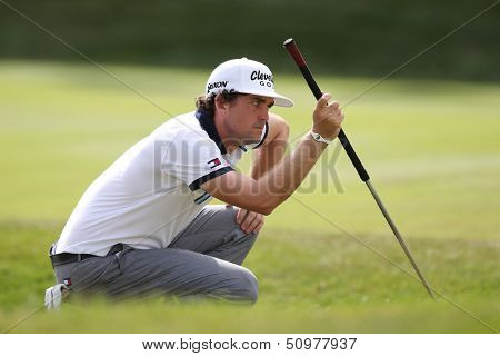 Sep 15, 2013; Lake Forest, IL, USA; Keegan Bradley reads the 18th green during the third round of the BMW Championship at Conway Farms Golf Club.