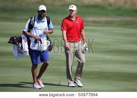 Sep 15, 2013; Lake Forest, IL, USA; Jordan Spieth (r) and caddie Michael Greller walk the eighth fairway during the third round of the BMW Championship at Conway Farms Golf Club.