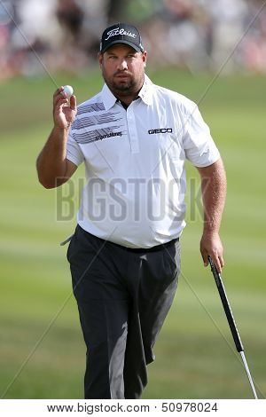 Sep 15, 2013; Lake Forest, IL, USA; Brendon de Jonge waves to the crowd after putting the 18th green during the third round of the BMW Championship at Conway Farms Golf Club.