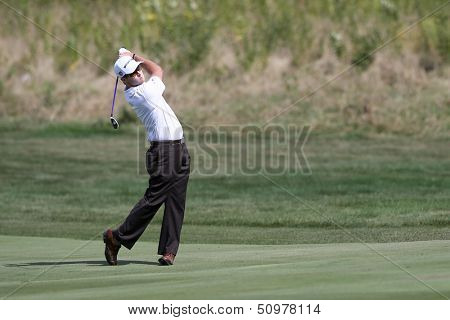 Sep 15, 2013; Lake Forest, IL, USA; Kevin Streelman hits a fairway shot on the eighth hole during the third round of the BMW Championship at Conway Farms Golf Club.