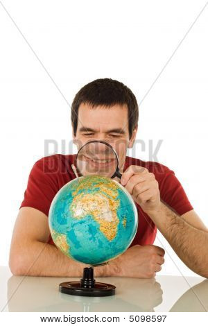 Man Looking At Globe