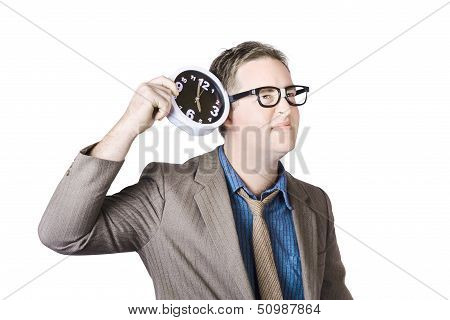 Businessman Listening To Clock