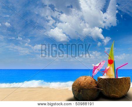 Paradisiac beach in the tropics with fresh coconut cocktail