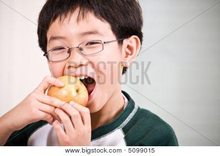 A Boy Eating An Apple