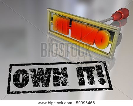 The words Own It on a branding iron to illustrate the concept of ownership and claiming responsibility