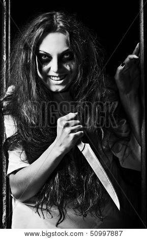 Horror Style Shot: Crazy Evil Girl With Knife In Hands. Black And White