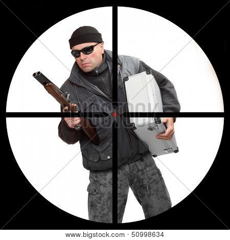 Dangerous gangster or terrorist in a police sniper's scope. Security and insurance concept.