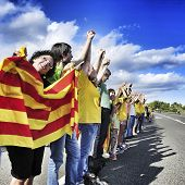 AMETLLA DE MAR, SPAIN - SEPTEMBER 11: Partakers in the Catalan Way on September 11, 2013 in Ametlla,