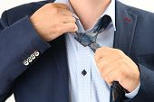 foto of take off clothes  - tired businessman taking off necktie - JPG