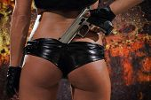 picture of breastplate  - Sexy woman with gun over grunge background - JPG