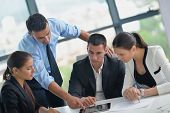 stock photo of meeting  - Group of happy young  business people in a meeting at office - JPG