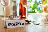 picture of salt shaker  - Reserved sign on a restaurant table - JPG