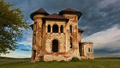 stock photo of abandoned house  - Old abandoned haunted house and sky in Transylvania with clouds - JPG