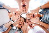 stock photo of screaming  - summer holidays and teenage concept  - JPG