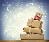 pic of piles  - Stack of handmade gift boxes over snowing night background - JPG