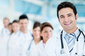 stock photo of team  - Male doctor at the hospital with his team - JPG