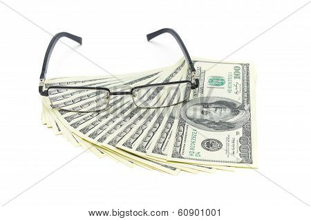 U.s. Dollars And Glasses Isolated On White Background