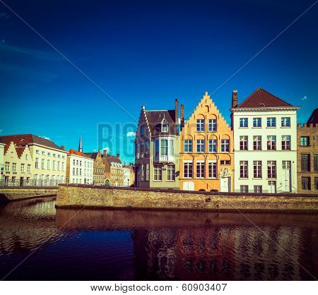 Vintage retro hipster style travel image of Europe town travel background - canal and medieval houses. Bruges (Brugge), Belgium