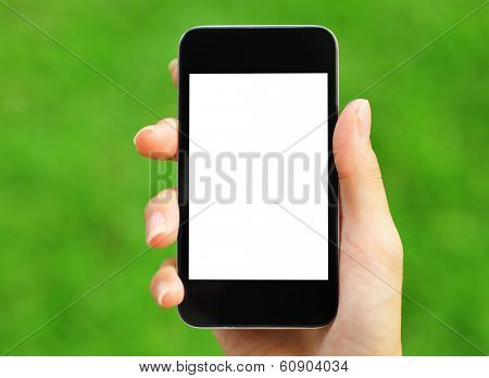 Woman hand holding mobile with green background