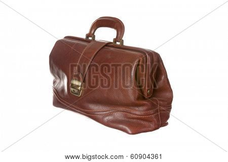 Antique doctor's bag in cowhide filled with medical instruments