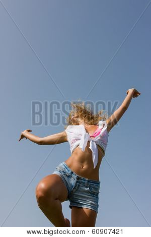 young woman in jeans shorts in the summertime