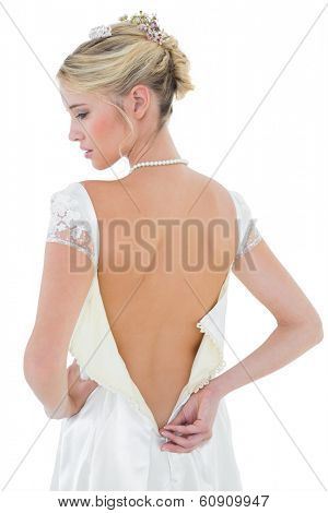 Rear view of beautiful bride wearing wedding dress over white background