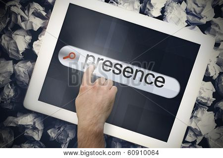 Hand touching the word presence on search bar on tablet screen on crumpled papers