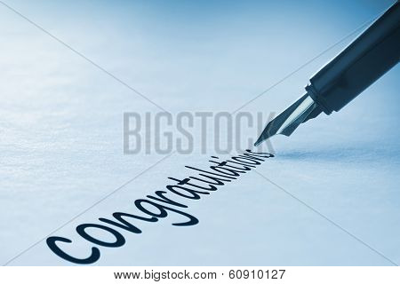 Fountain pen writing the word congratulations