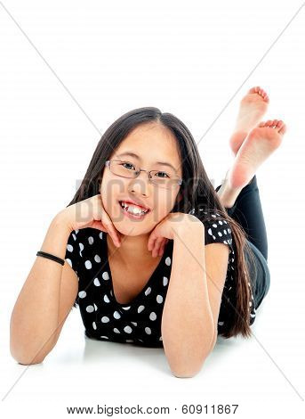 Cute Tween Lying On Floor In Casual Pose