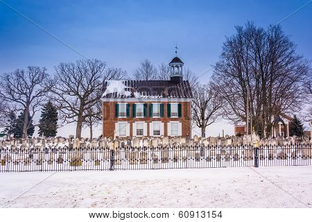 Snow Covered Cemetary And Old Building In Rural York County, Pennsylvania.